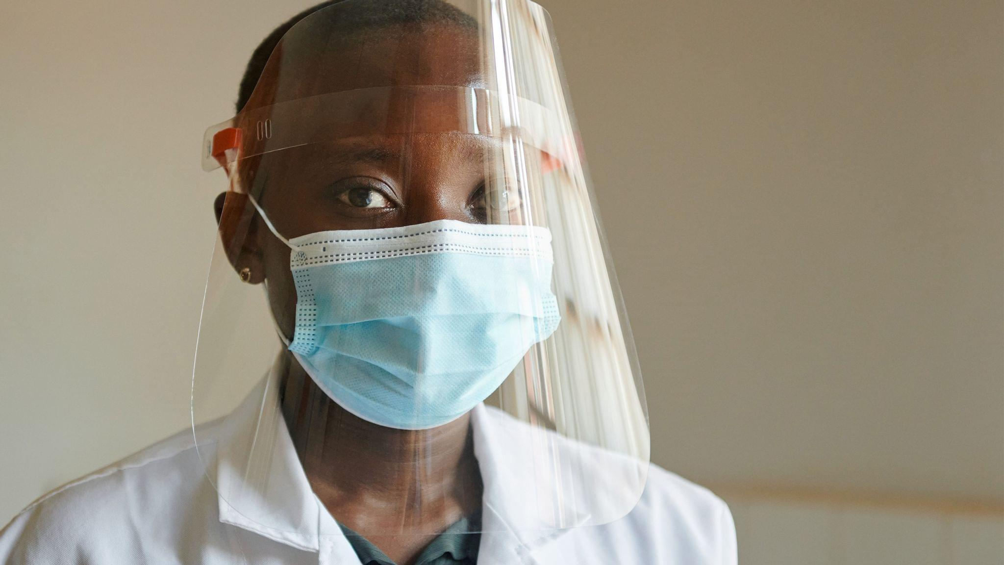 A Zambian healthcare worker wearing an Apple-produced face shield.